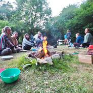 Dinner round the fire (c). Lisa Chapman