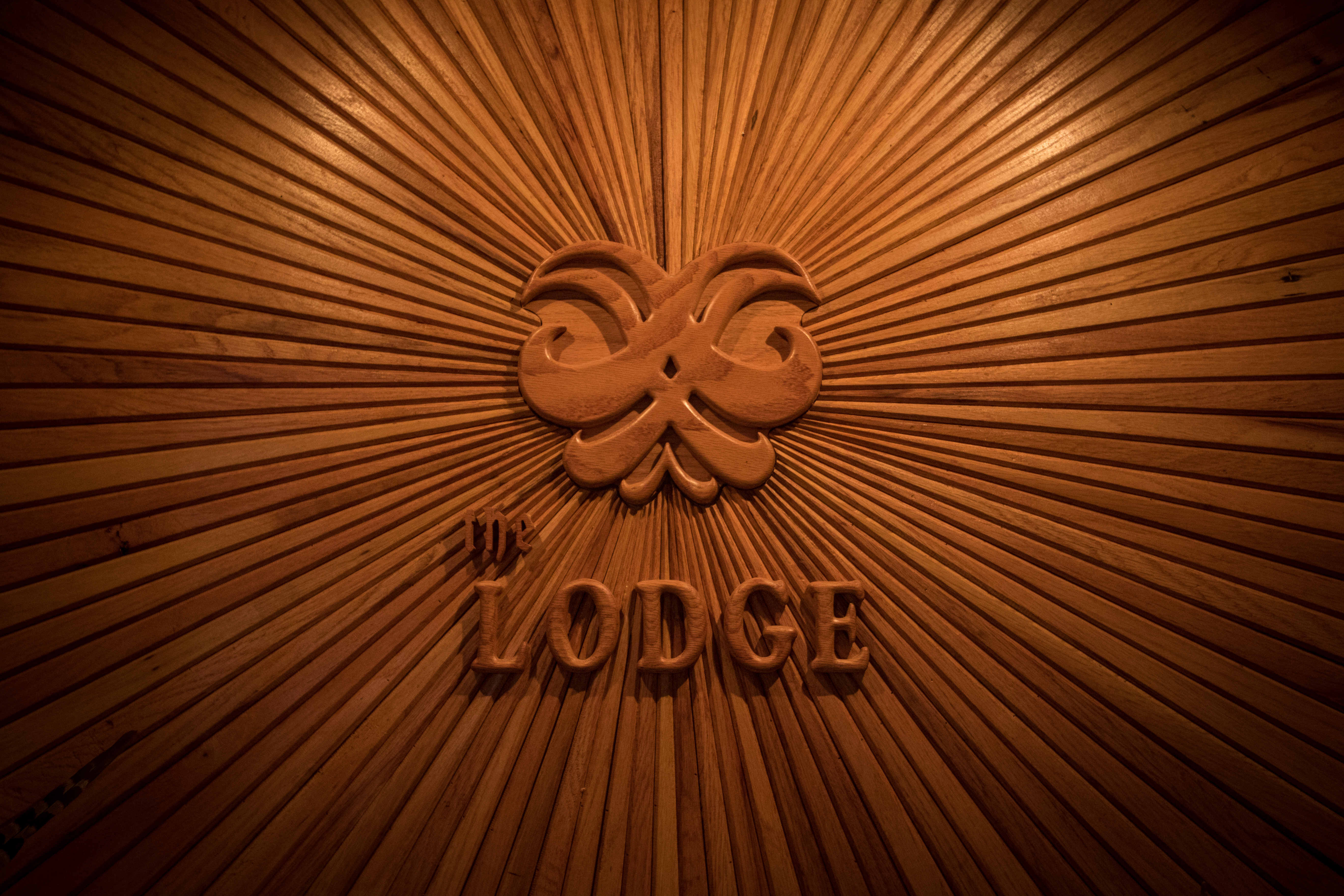 The Lodge Wine Cellar Wood Carving