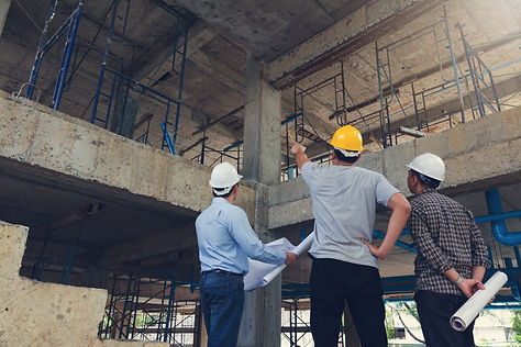 Construction concept of Engineer and Architect working at Construction Site with blue prin