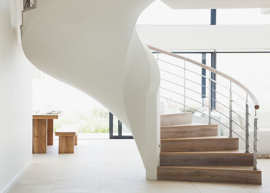 gallery-1476461376-curving-staircase-in-