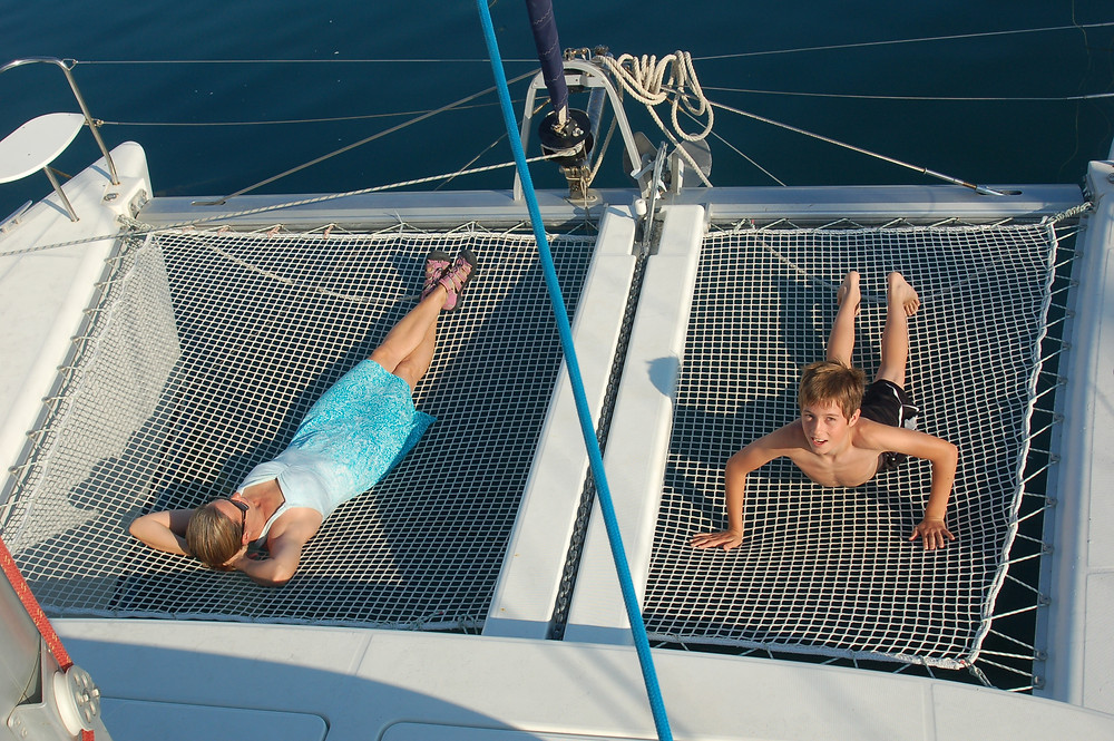 The boom net. A very desirable place on the boat during each sailing day!