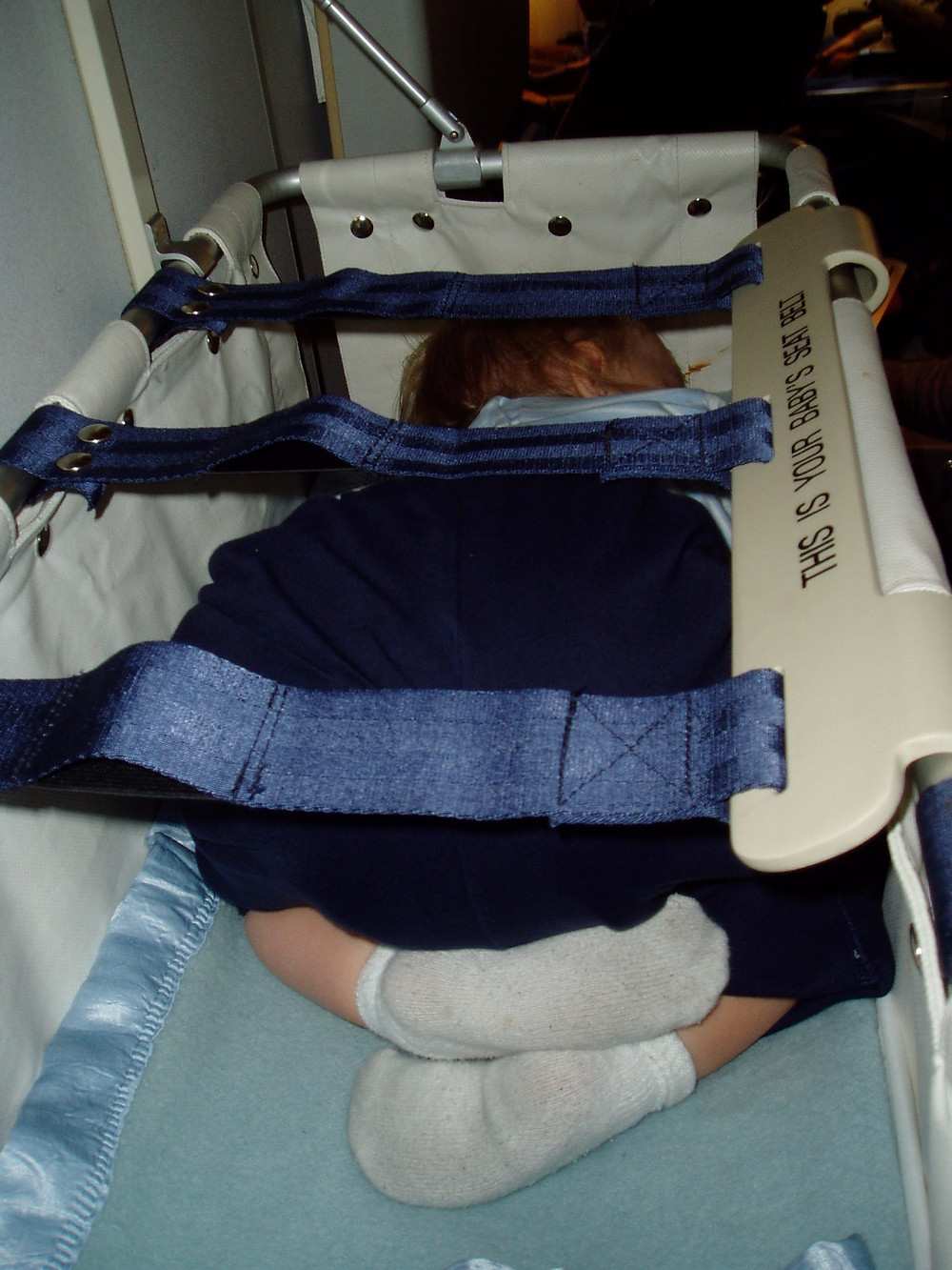 Our 15 month old on a long haul overnight flight