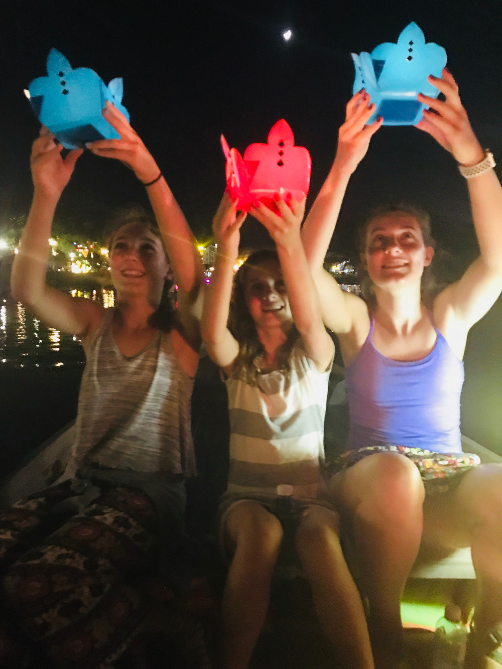 Placing lanterns into the river in Hoi An, Vietnam