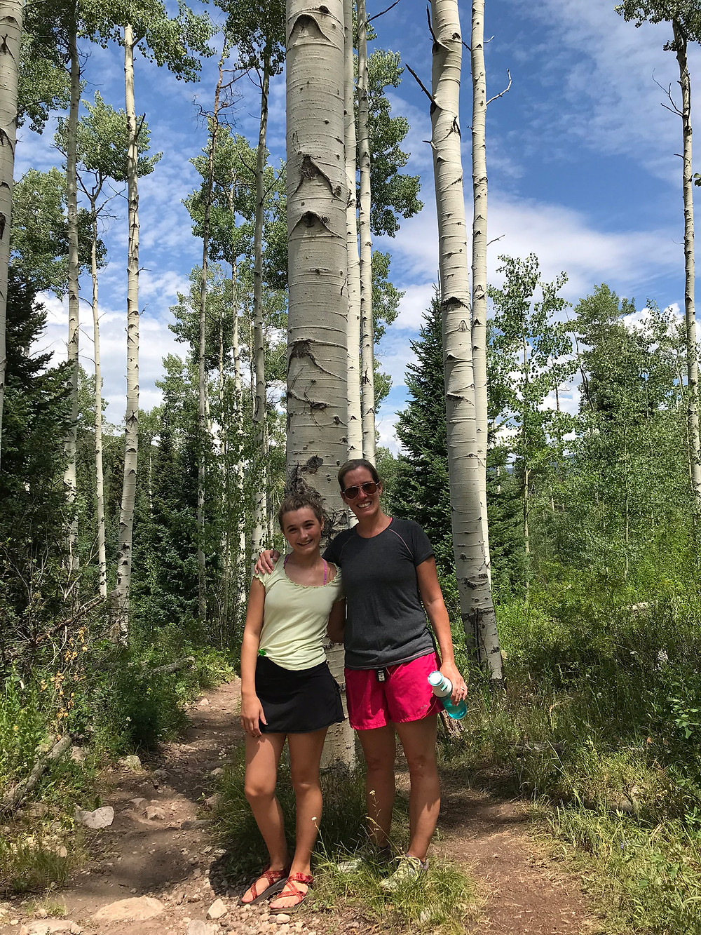 Hiking in an aspen grove in Vail, CO