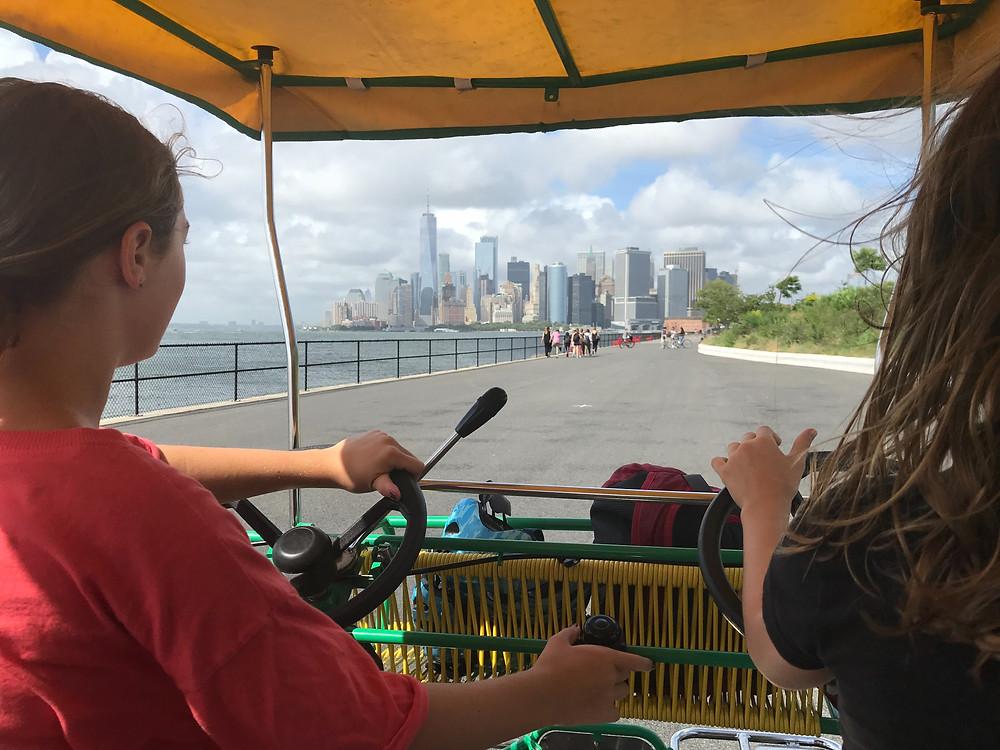 Biking on a surrey bike around Governor's Island, New York