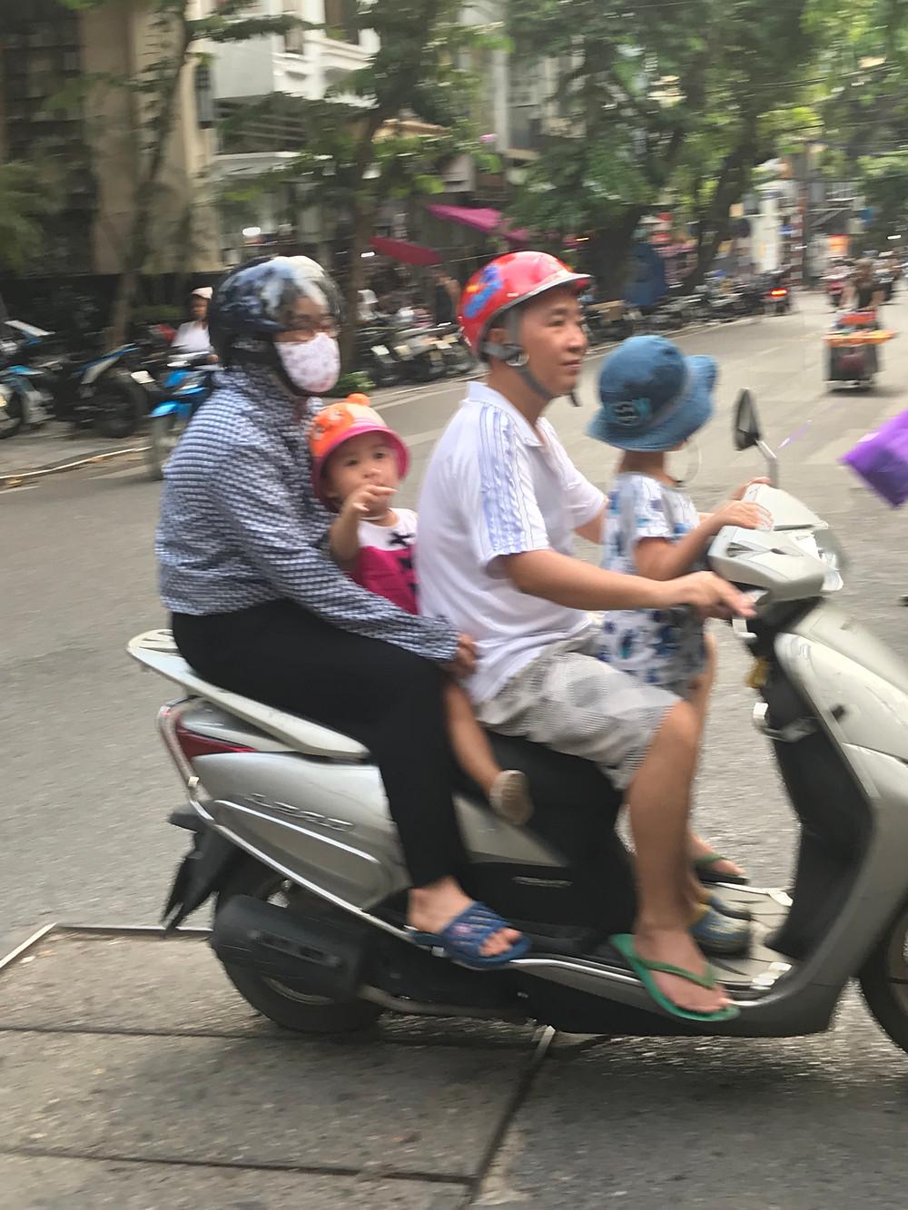 Family on moto in Hanoi, Vietnam