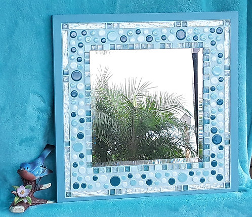 Wall decor mirror with round tiles in blues and whites