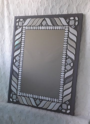 Gray and white tile mirror with mixed shapes