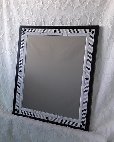 Black, white and gray tile mirror with bead accent.