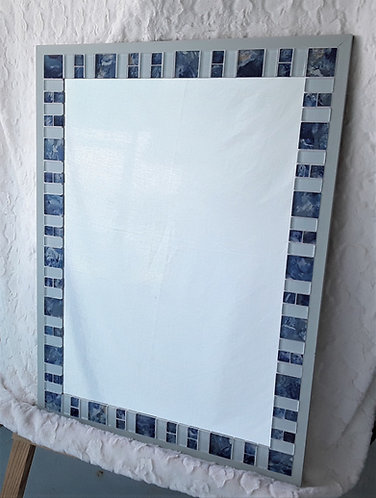 Large mirror with beautiful blue and seafoam tile