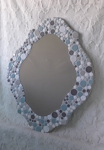 Funky shaped bubble mirror in soft blues and white.  Can be hung either way