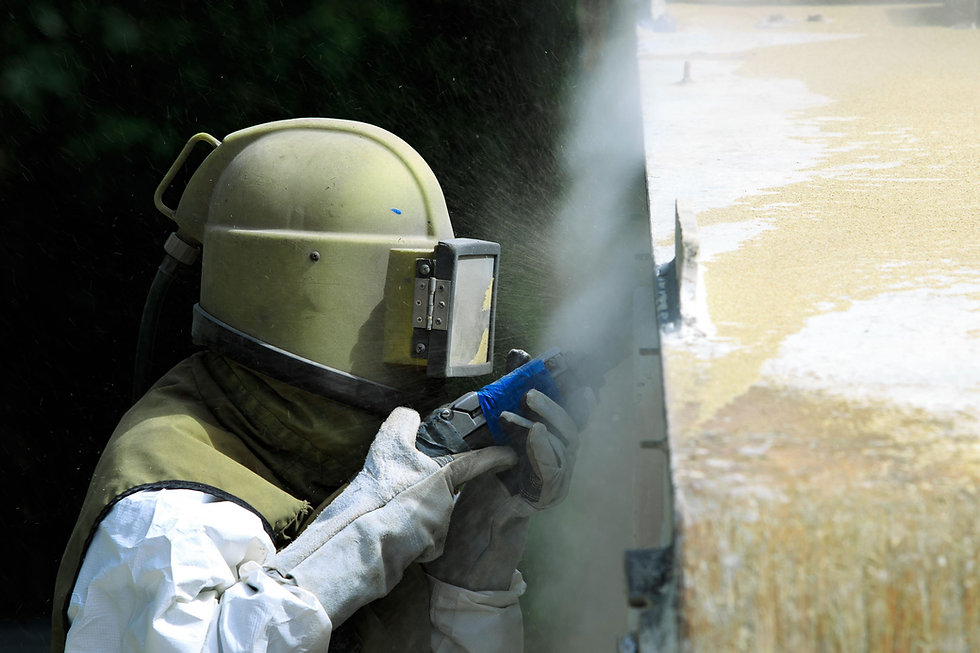 Worker Sandblasting Wall