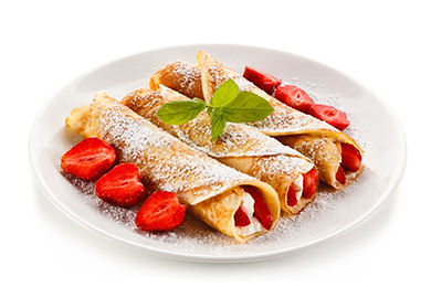 Crepes with strawberries and cream on wh