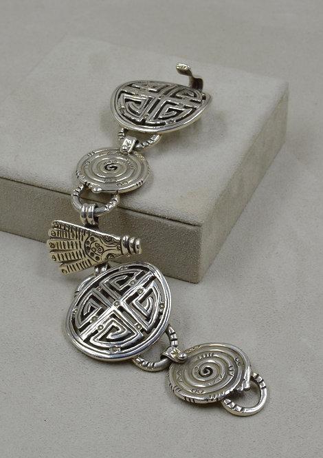 Hand-Forged Mongolian Glyphs & Hamsa Spirals Bracelet by Melanie DeLuca