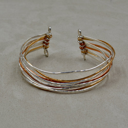 Sterling Silver, Copper, and Brass Hammered Cuff by Sippecan Designs