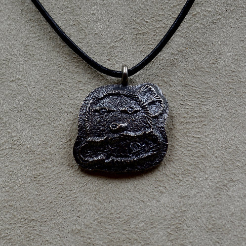 Oxidized Sterling Silver Tufa Yei Pendant on Leather by Massimo Misquadace