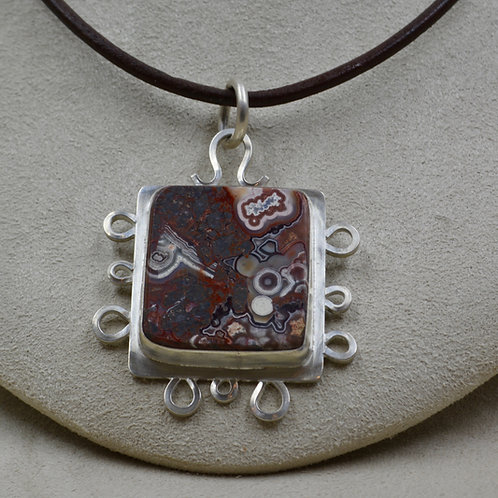 Crazy Lace Agate and Sterling Silver Pendant by Joe Glover