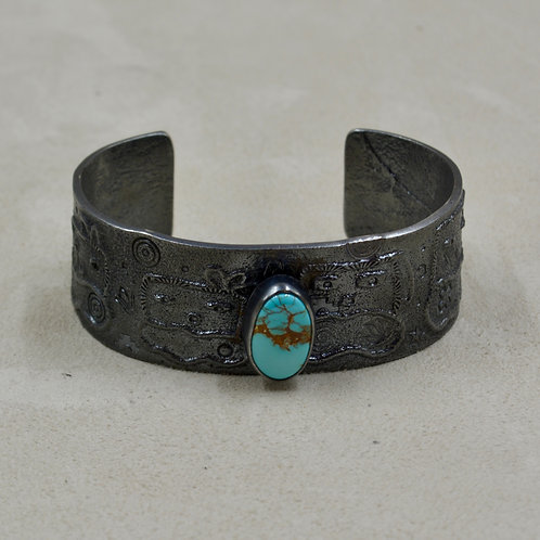 Oxidized Sterling Silver Tufa Yei & Turquoise Cuff by Massimo Misquadace