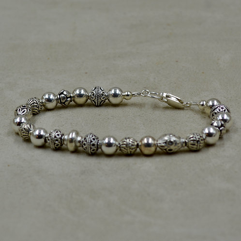 Assorted Sterling Silver Beads Bracelet by Sippecan Designs