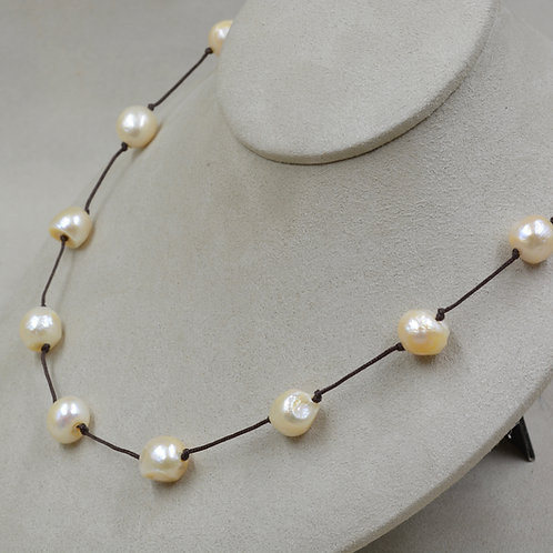 Cultured 10-12mm Peach Pearls on Black Cord Necklace by US Pearl Co.