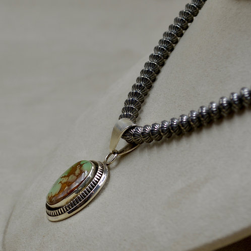 Sterling Silver and Natural Royston Turquoise Pendant by Bettilyn Nez