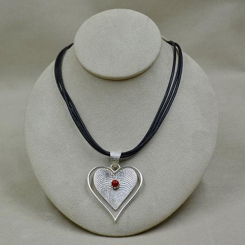 Medium Coral & Tufa Cuttle Heart on Leather by Althea Cajero