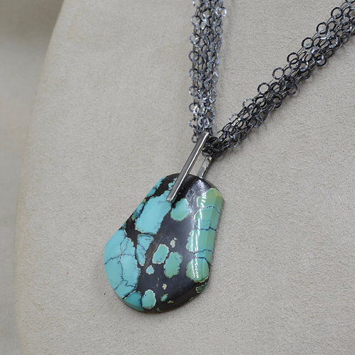 S. Silver Chinese Turquoise Cab w/ Black Rhodium Bale by Reba Engel