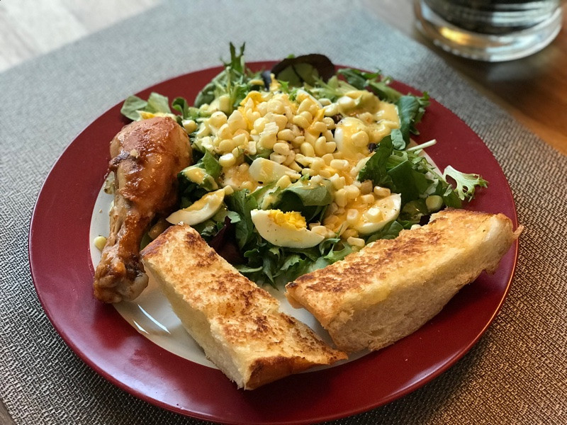ingredient  organic spring mix ( baby lettuce and baby greens)  corn on the cob  onion ( optional )  hard boiled egg baked chicken   Dressing Honey mustard (Lite)  Simple Italian dressing   Bread Toast a slice of french on the skillet with butter until brown