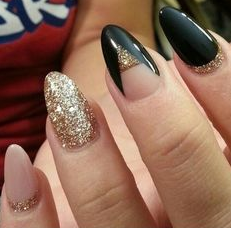 black and nude nails with gold glitter