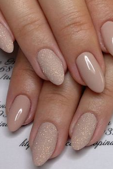 nude matte gold glitter nail design