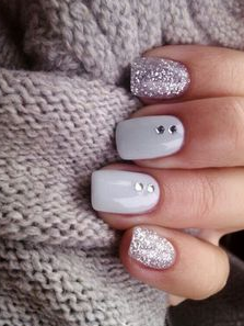 white nails with glitter and gem accents