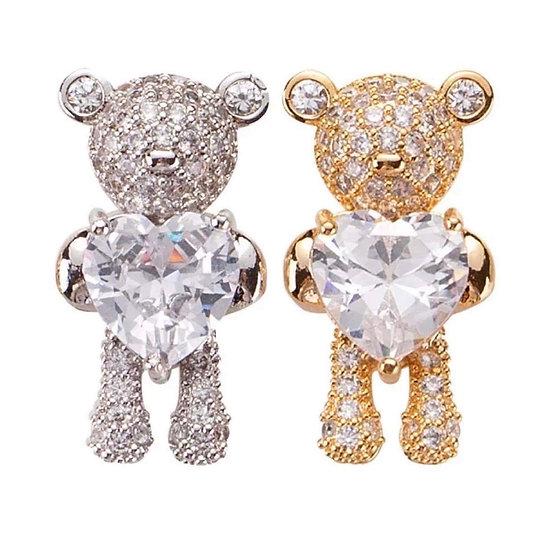 Bears holding heart charms