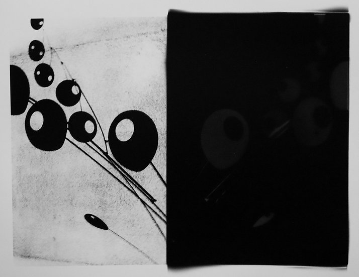Abstraction of Calder mobile; positive and negative half/half