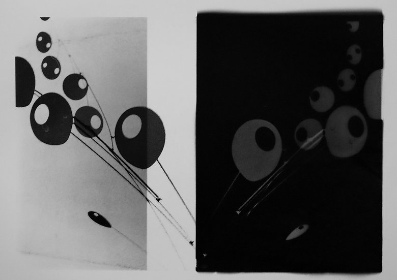 Abstraction of Calder Mobile; positive and negative with middle white stripe