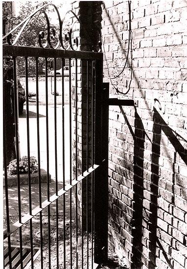 Brick Wall with Iron Gate