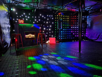 Party tent with Disco lights starlight backdrop illuminated bar sign