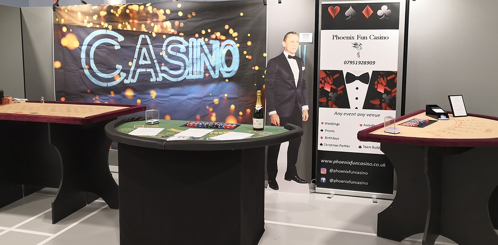 casino tables with casino banner backdrop