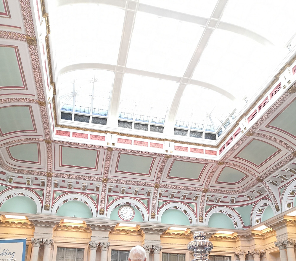The ornate ceiling in the sansovino room in the Harbour hotel bristol. grand stone pillars with glass ceiling