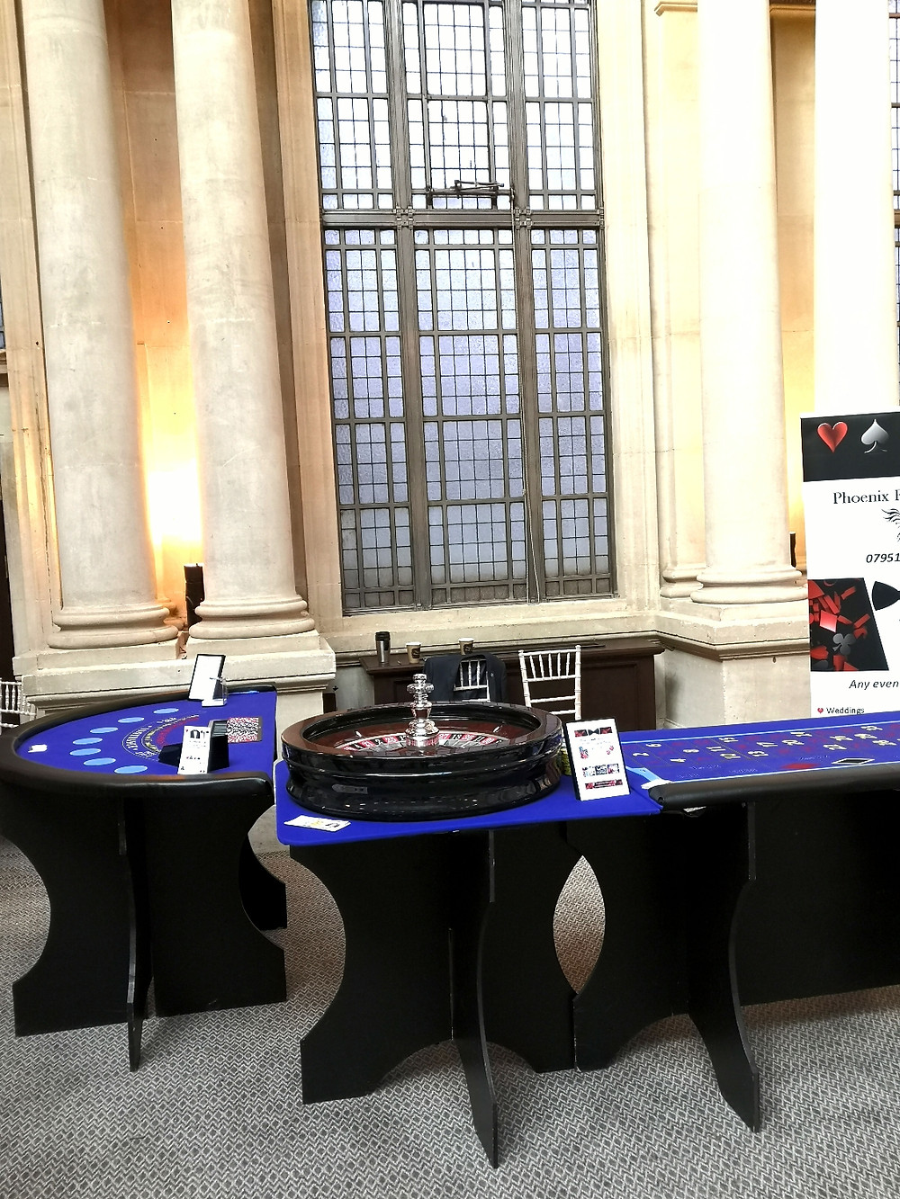 Blue roulette table and blue blackjack table