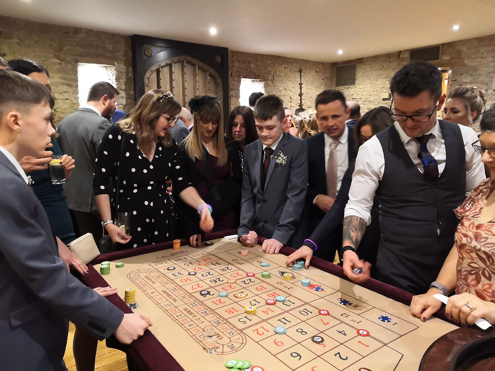 wedding guests playing roulette at the great tythe barn in tetbury