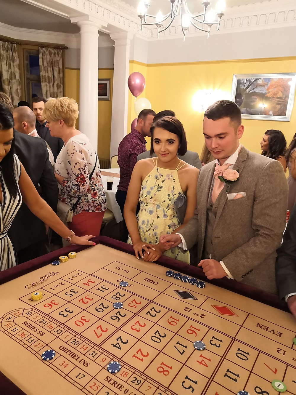 Wedding guests playing roulette