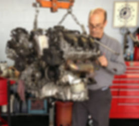 European Sales & Service Technician repairing Mercedes-Benz engine