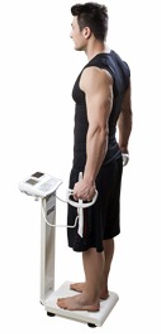 Man being weighed on a Tanita Body Composition Analyzer