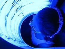 Man sitting in front of a Blu-U Light