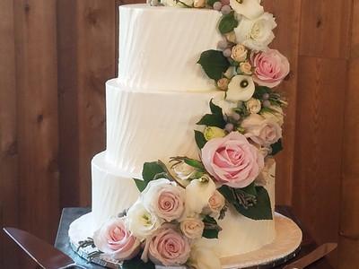 Wedding cake w/ cascading florals