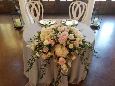 Sweetheart table w/ large arrangement