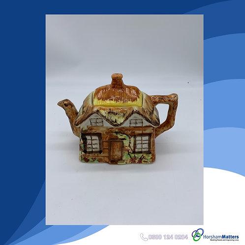 Ceramic thatched house tea pot