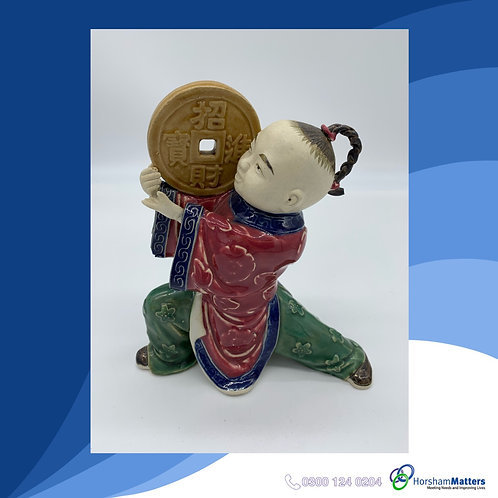 Traditional Japanese boy statue
