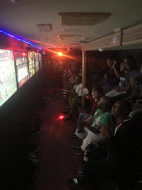GamerBus+inside+with+kids-1920w.webp