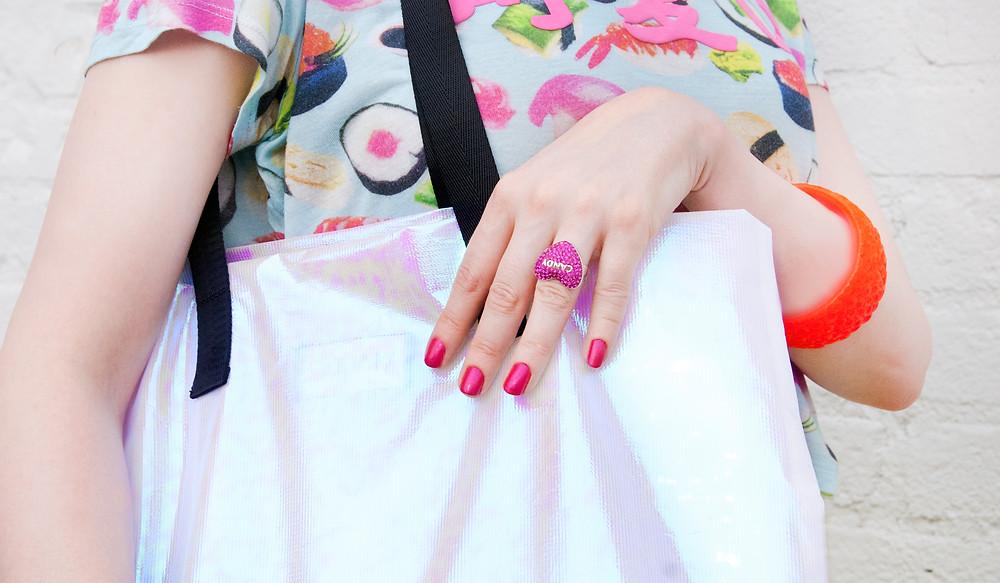 Sara wears Sara Gallo Jewelry Candy Heart Ring in Candy Fuchsia